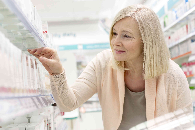 Woman choosing a retinoid skin care product