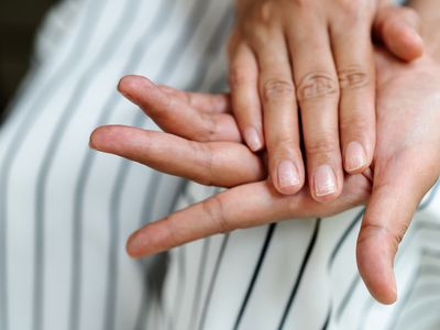 A person with their two hands together showing nails