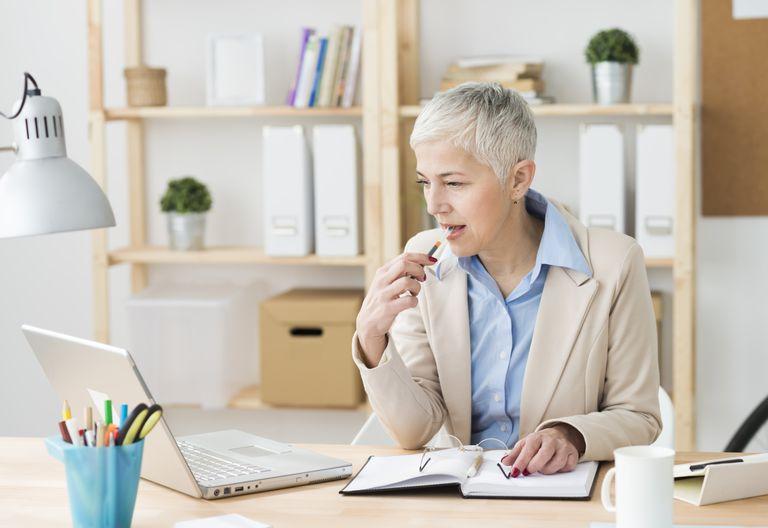 Woman looking at laptop.