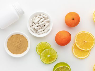 Hesperidin capsules, powder, limes, and oranges