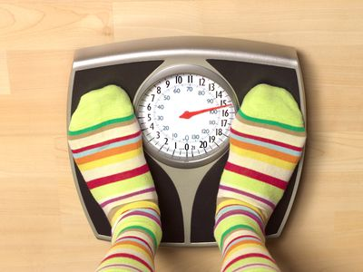 Overweight woman on bathroom scales