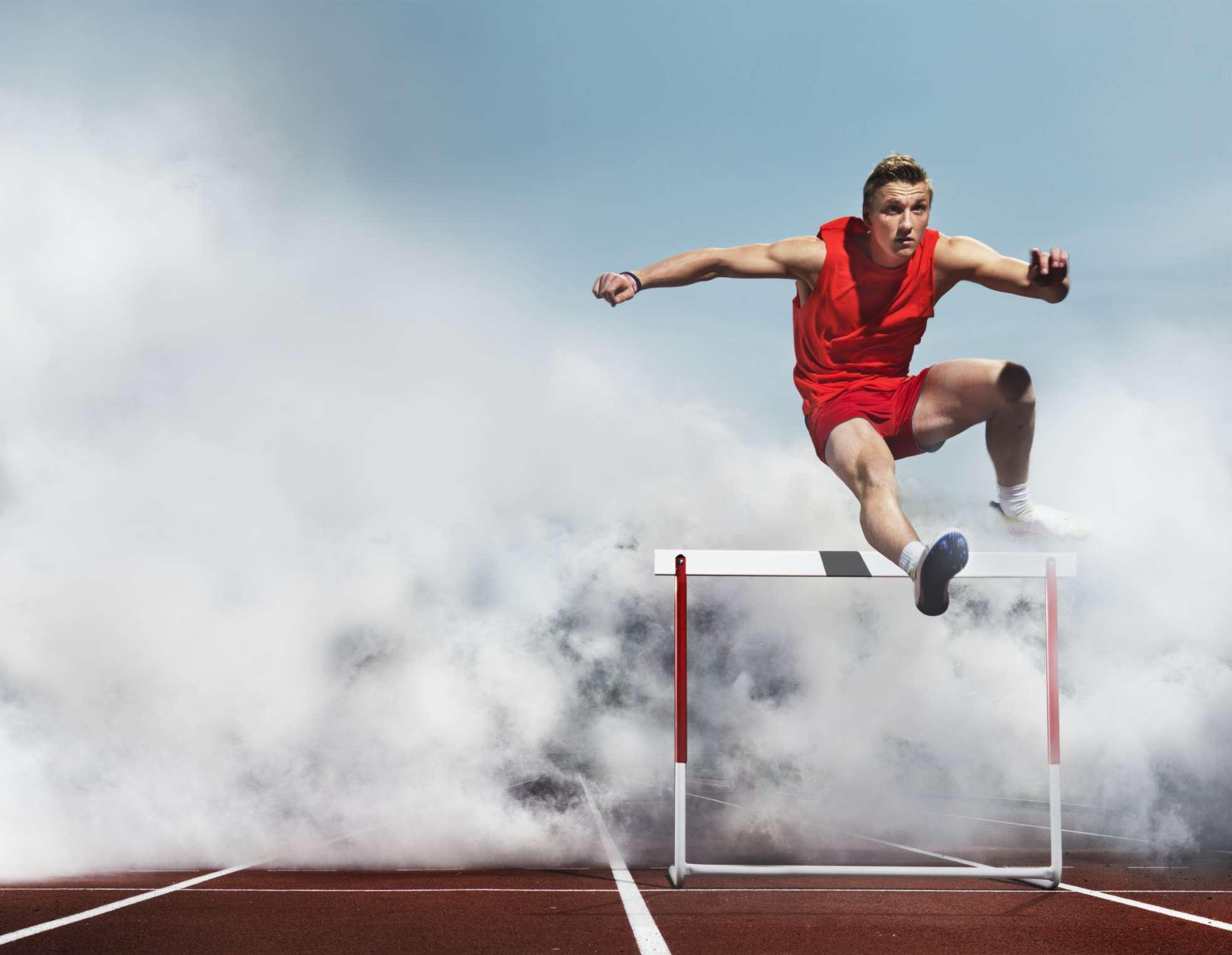 Young athlete hurdling