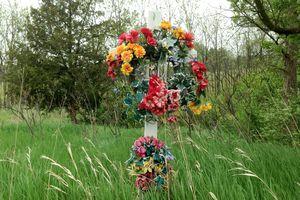 A roadside memorial in a grassy field