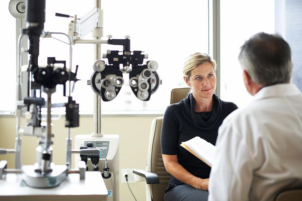 Woman talking with eye doctor