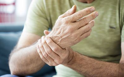 Middle aged man with wrist pain