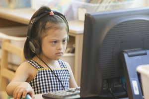 Down syndrome student using computer