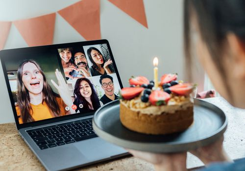 woman celebrating birthday on a video call