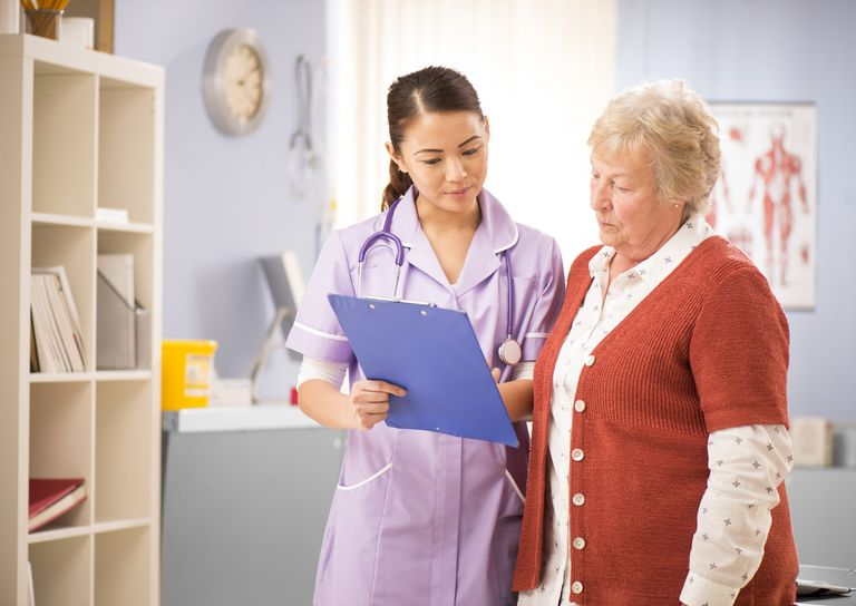 nurse chats with senior patient