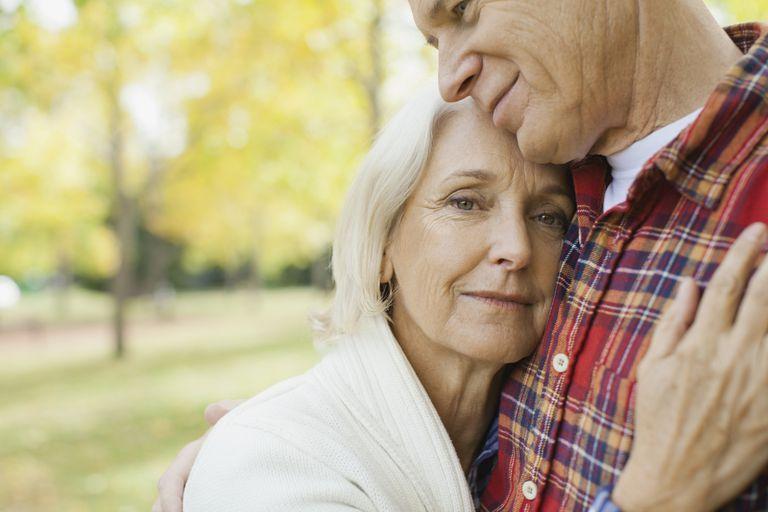 Older woman hugging husband