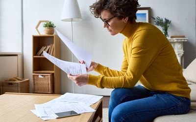 Woman doing her taxes at home