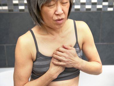 person experiencing heartburn