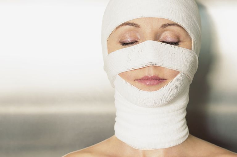 Woman with her face and head bandaged