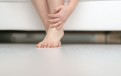 Woman rubbing her ankle