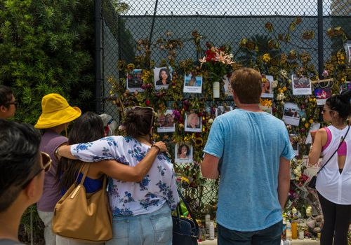 Families at the Surfside condo collapse memorial.