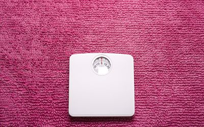 scale on pink rug