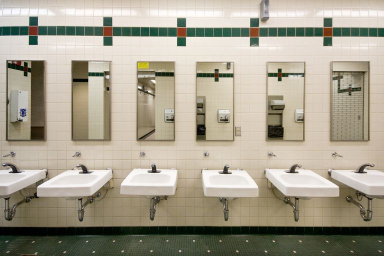 interior of public washroom sinks and mirrors