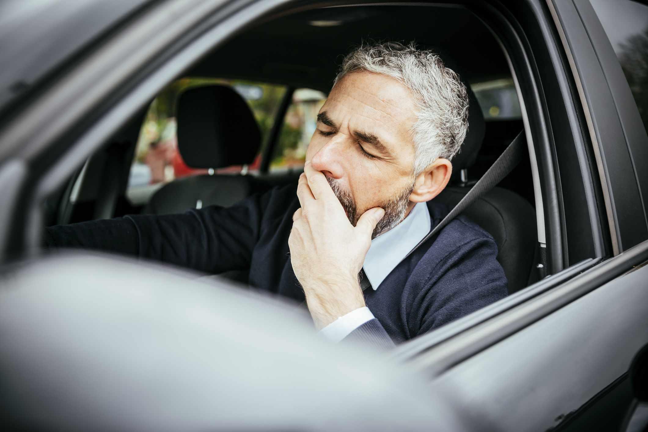 Man falling asleep behind wheel while driving