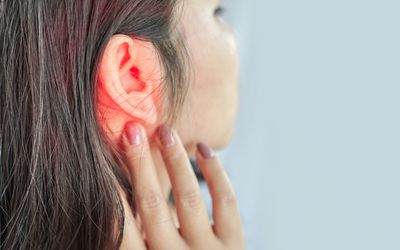 woman suffering from ear pain , Tinnitus concept