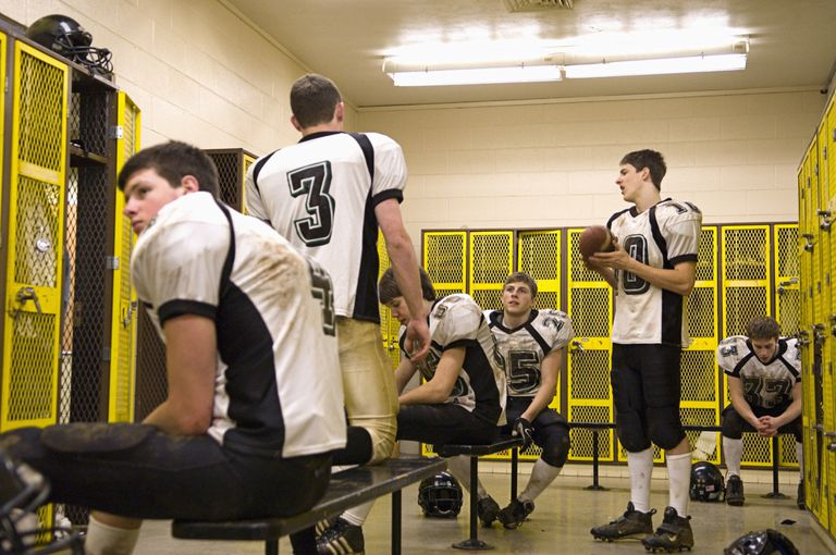 Football players in a locker room