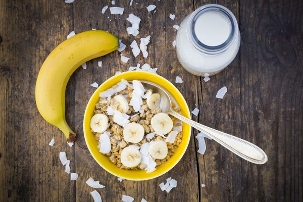 Bowl of granola with bananas