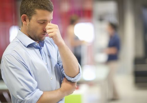 stressed man at office