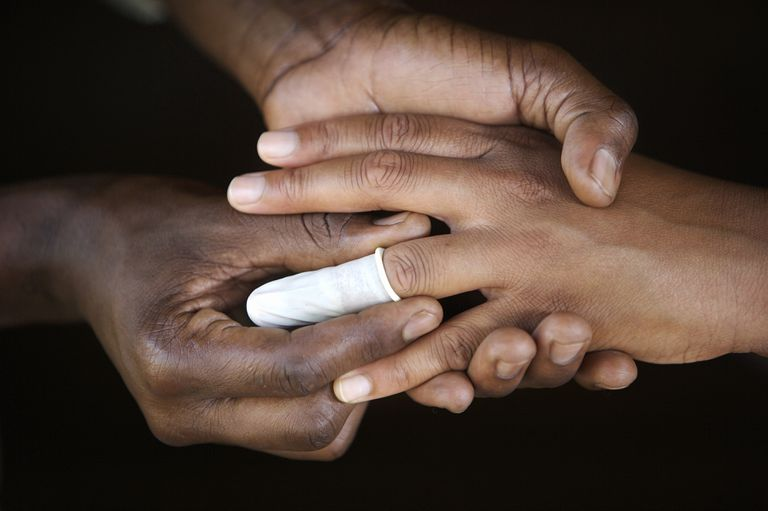Man symbolically placing a condom on ring finger of women, Gauteng Province, South Africa