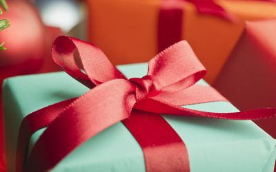 Festively wrapped Christmas gift, close-up
