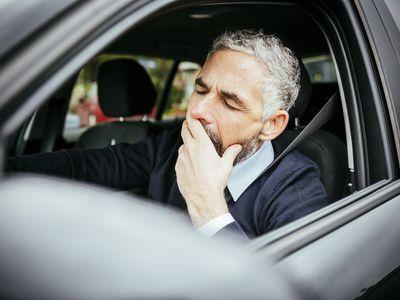 Man falling asleep behind while driving