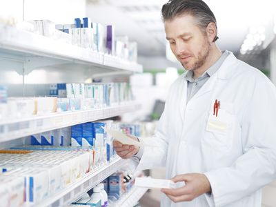 A pharmacist works on a prescription.