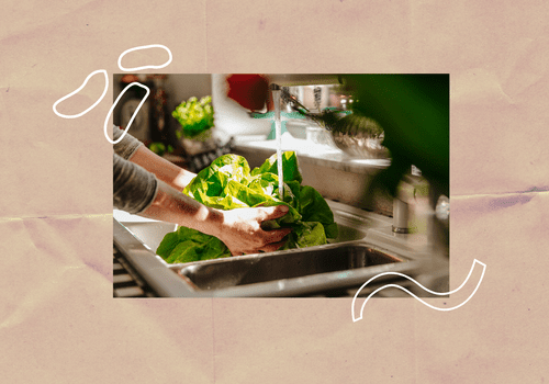 Someone washing lettuce in a kitchen sink.
