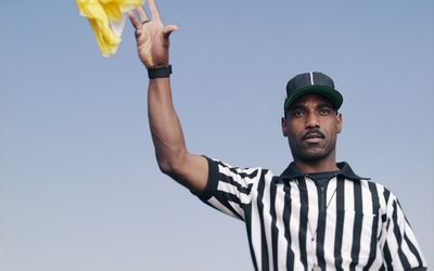 Referee throwing a penalty flag