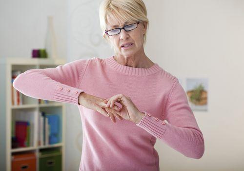 Mature woman holding hand