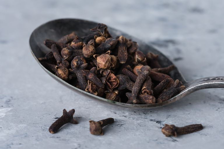 Close-Up Of Cloves In Spoon On Table