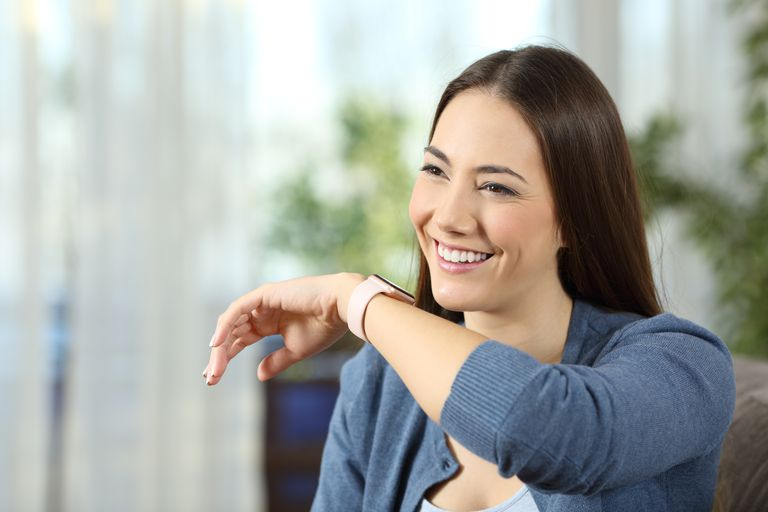 Woman talking to her smart watch