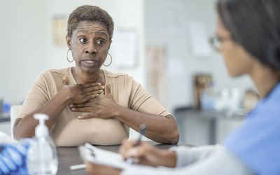 person speaking with healthcare provider