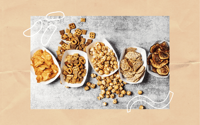 pretzels, chips, and popcorn in paper trays