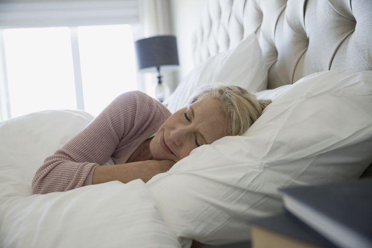 Comfortable woman sleeping in bed in wicking pajamas