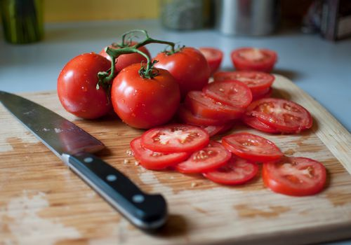 tomato slices on a cutting board