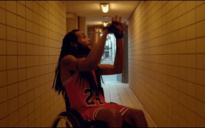 man in basketball uniform in wheelchair