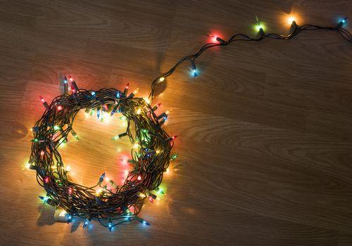 Coil of light christmas lights lying on floor