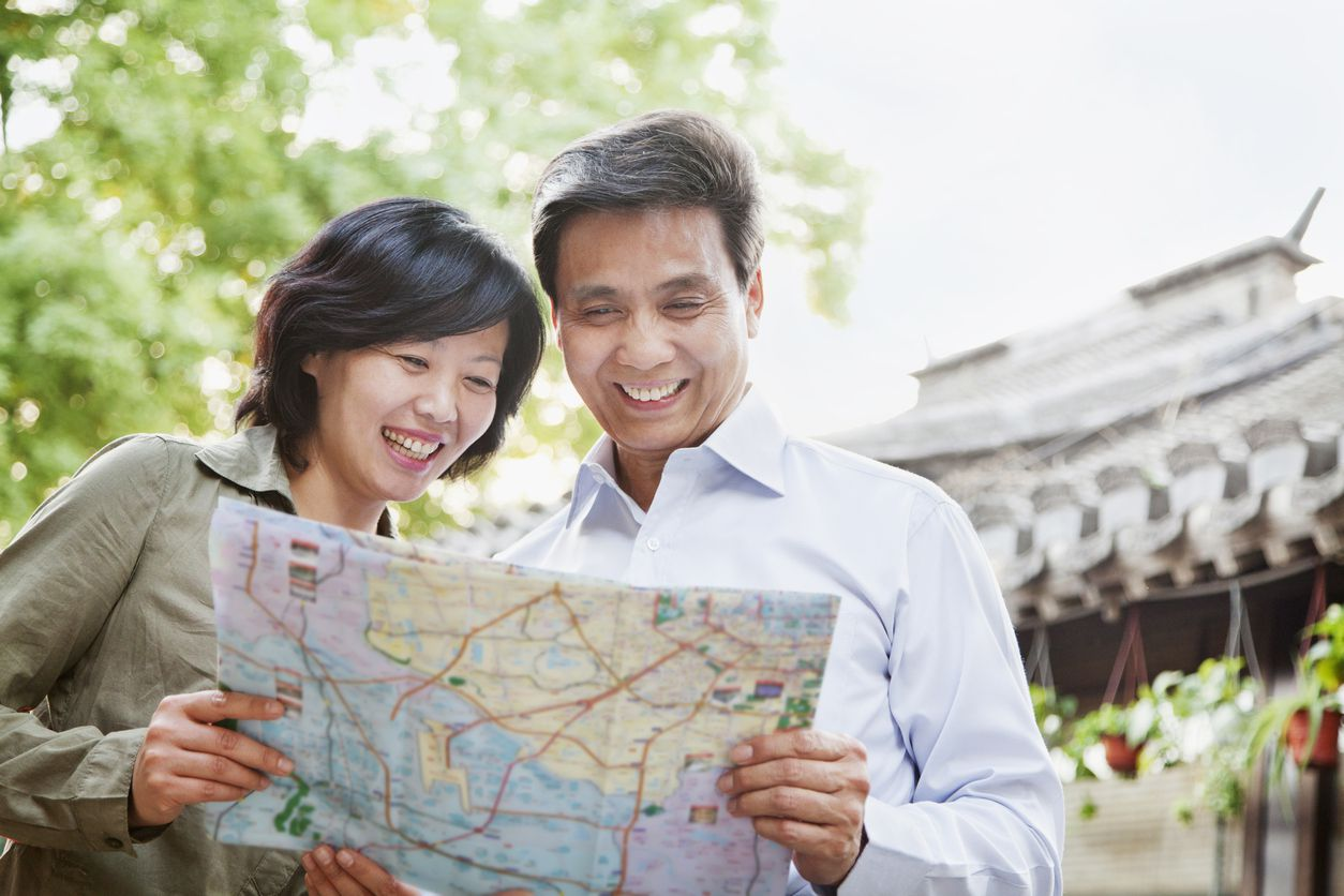 Asian couple reading map