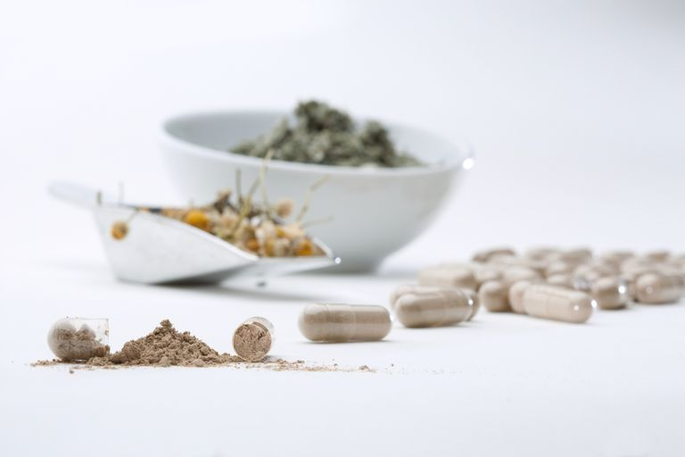 Herbs being ground into supplements