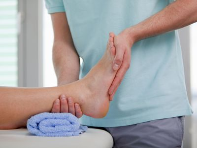 a doctor holding a patient's foot