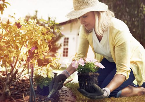woman gardening as a form of exercise to lower her lung cancer risk