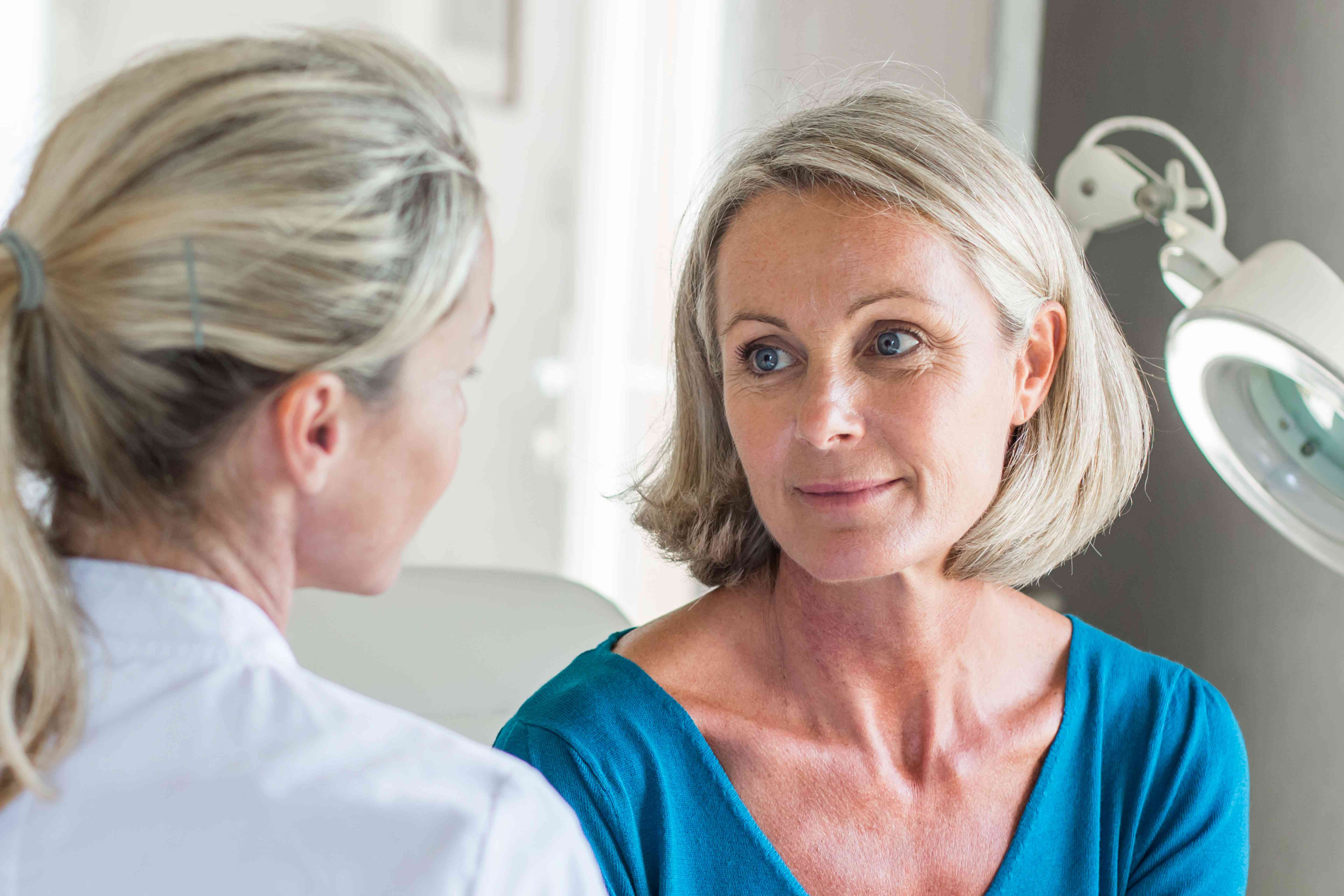 A woman talking to her doctor