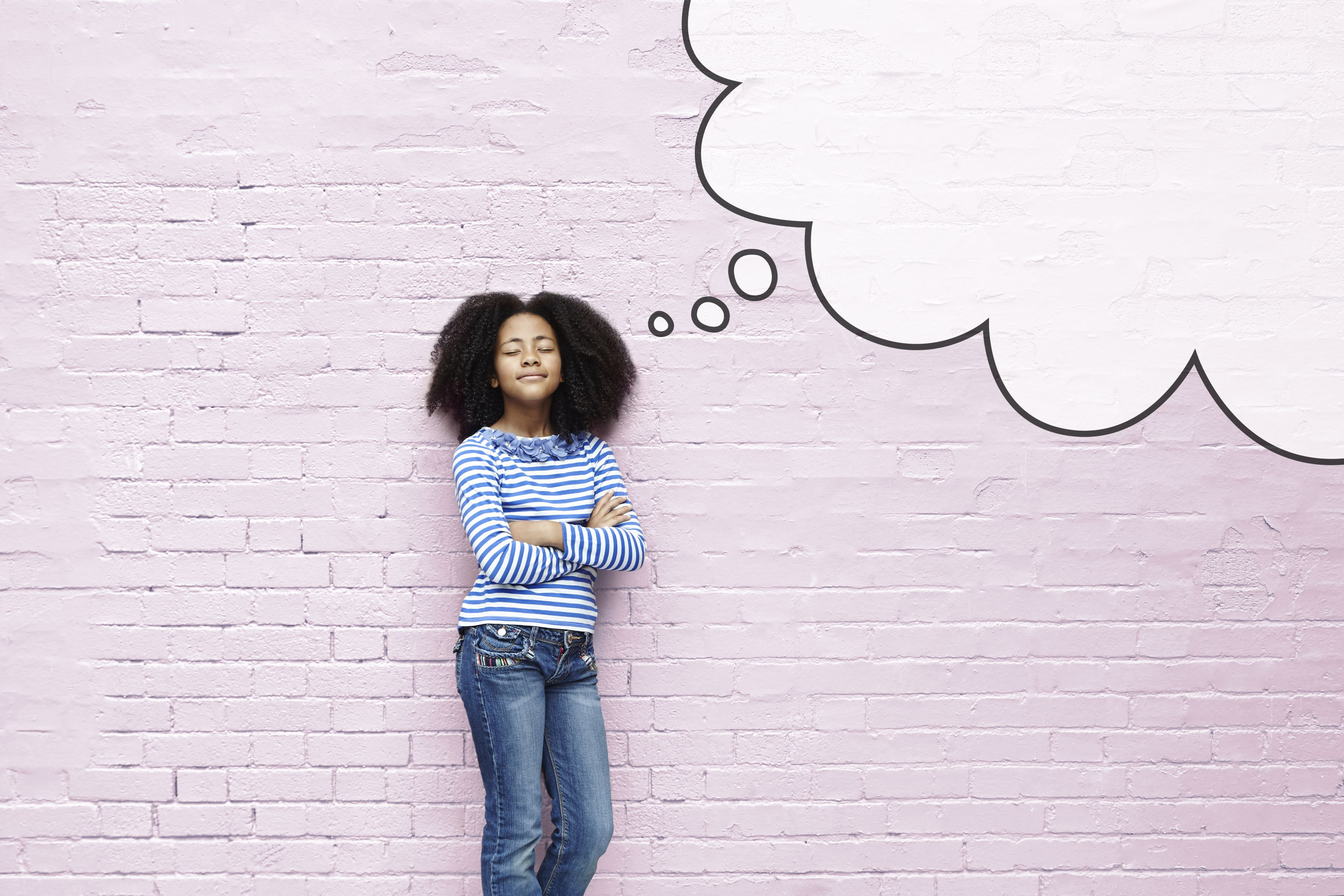Girl standing in front of a pink wall with a thought bubble drawn beside her