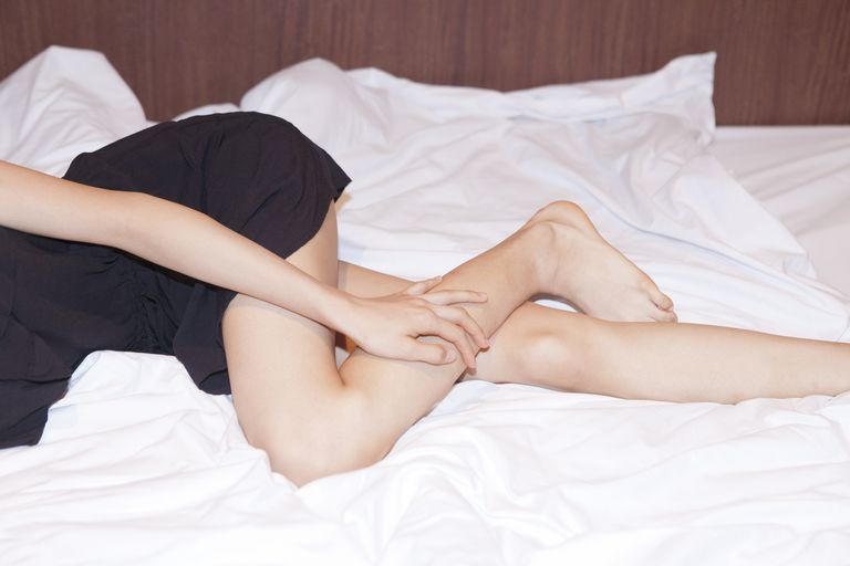 woman with restless legs in bed