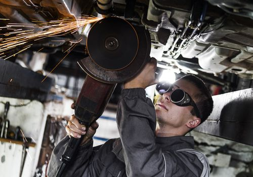 man wearing protective goggles while working