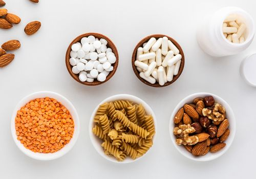 Benfotiamine capsules, tablets, almonds, lentils, and pasta