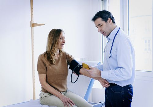 Doctor taking a patient's blood pressure